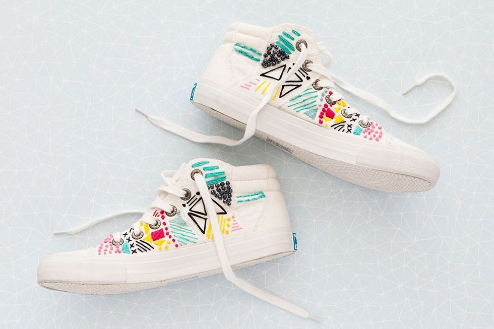 white sneakers with colored embroidery