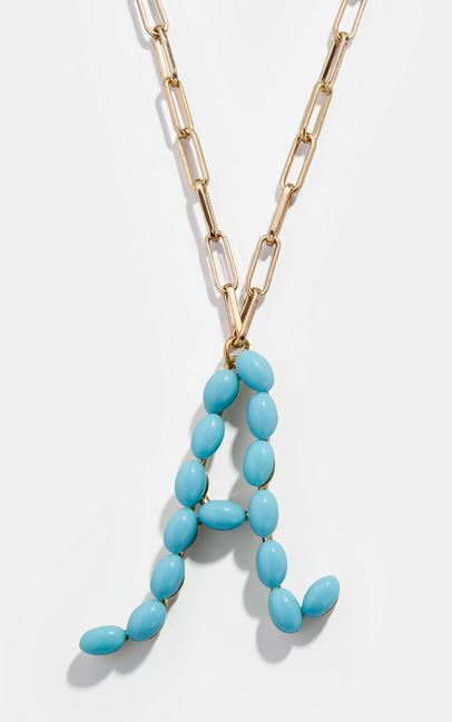 2020 jewelry trends: Beaded initial jewelry. Example of a blue letter necklace.