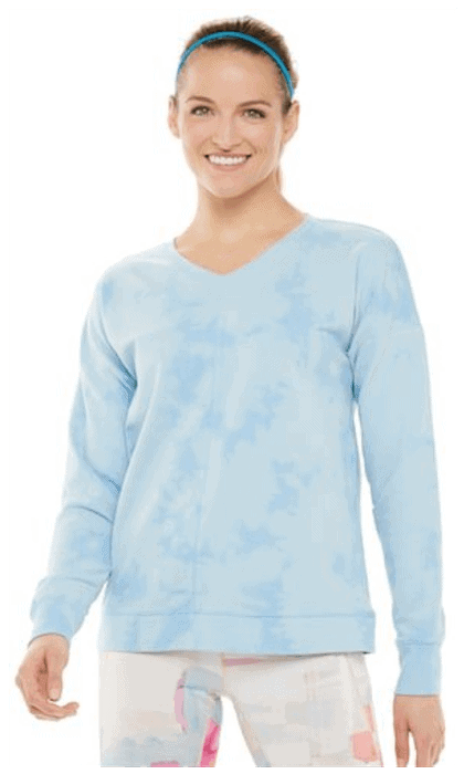 Model wearing Women's Tek Gear® Tie-Dye French Terry Sweatshirt in Pale Blue, skinny blue headband, and printed leggings, standing against white background