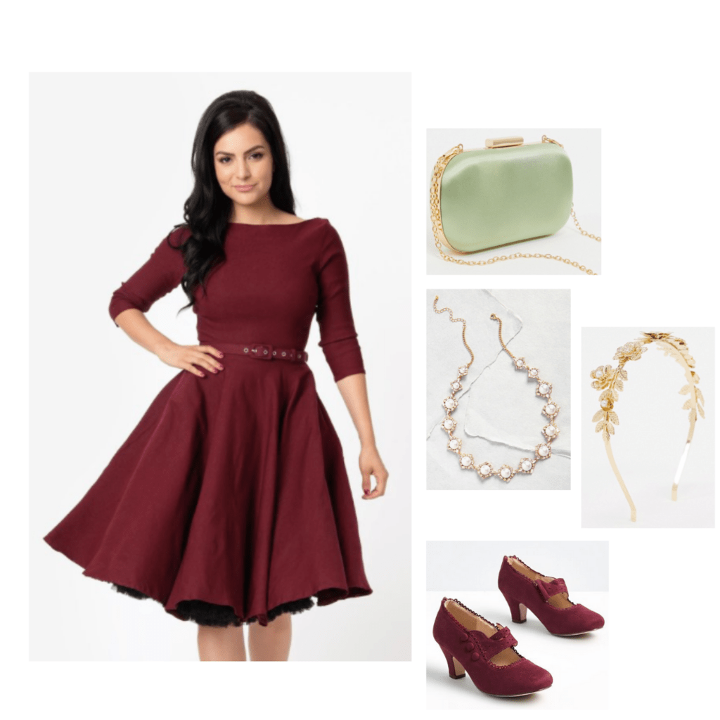 Outfit inspired by The Great: marroon a-line dress with long sleeves, marroon cheels, green purse with gold chain strap.