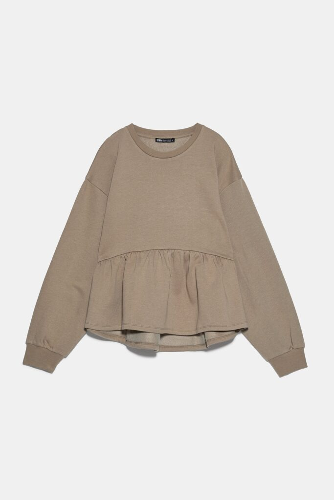 Peplum Sweatshirt in Khaki, shown against pale gray background