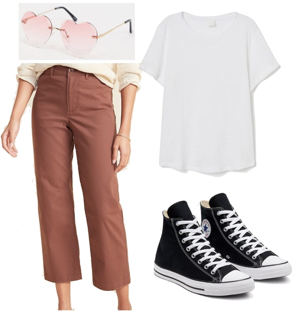Ana de Armas Outfit: white t-shirt, pink cropped chino pants, pink rimless heart sunglasses, and black high top Converse Chuck Taylor All Star sneakers