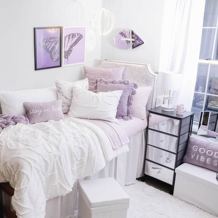 Purple and white dorm room from Dormify
