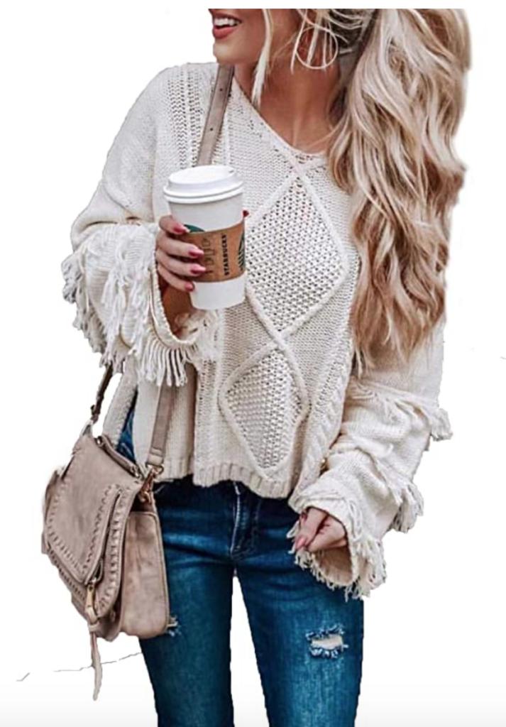 Slouchy fringed knit sweater in beige