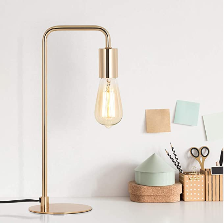 Gold desk lamp with exposed edison bulb