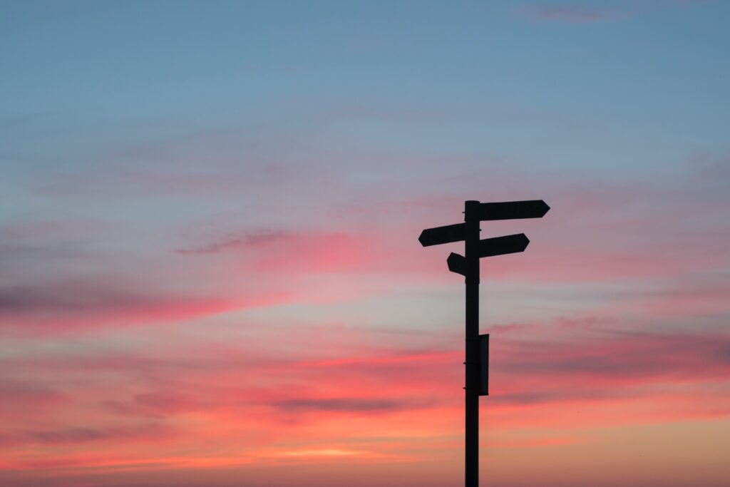 sign silhouette against sunset