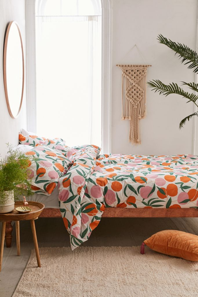 Orange and green dorm room from Urban Outfitters