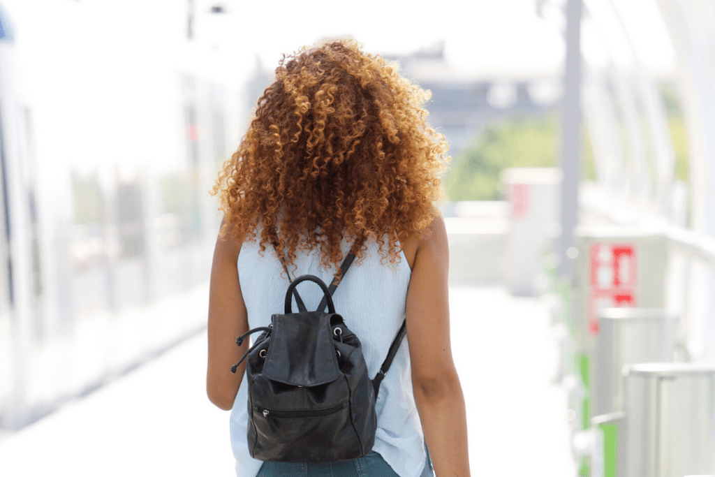 Photo of a woman walking away with her back turned