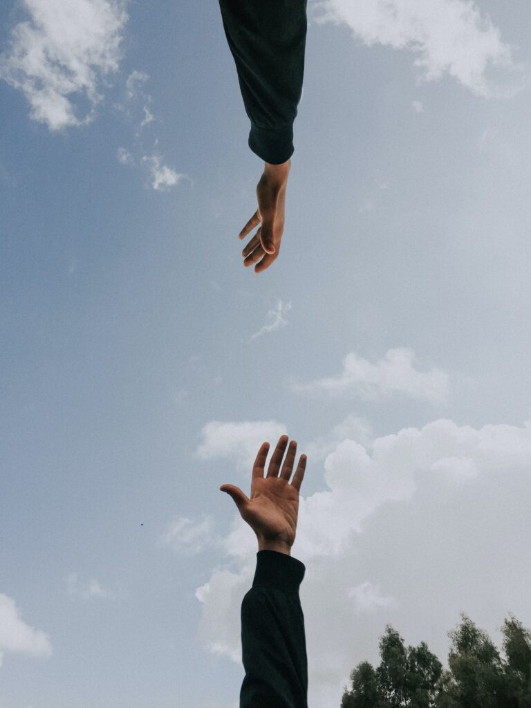 hand reaching for other hand