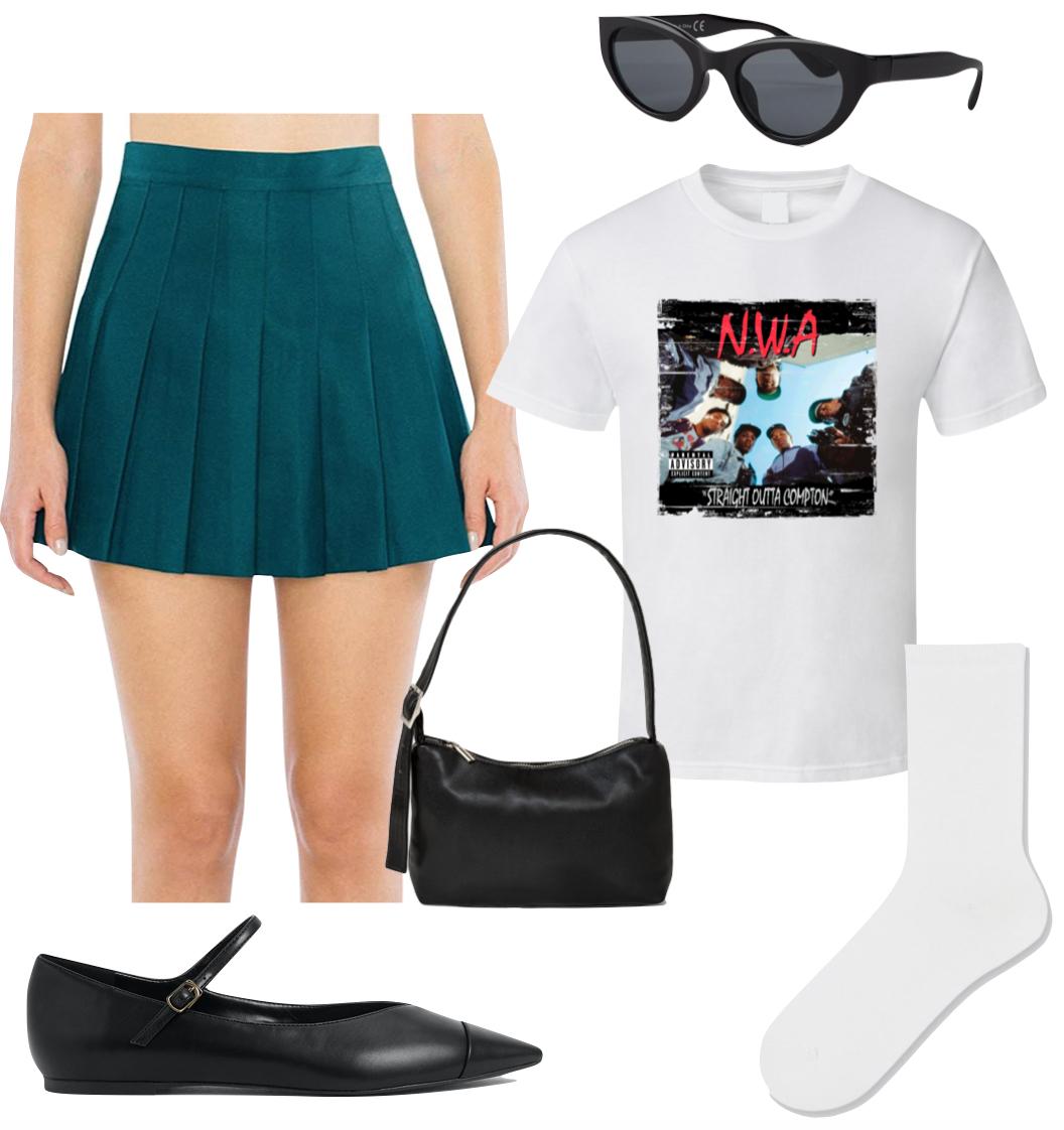 Zoe Kravitz Outfit 1: green pleated mini skirt, N.W.A. band t-shirt, black oval cat-eye sunglasses, white socks, black Mary Jane flats, and a black shoulder bag