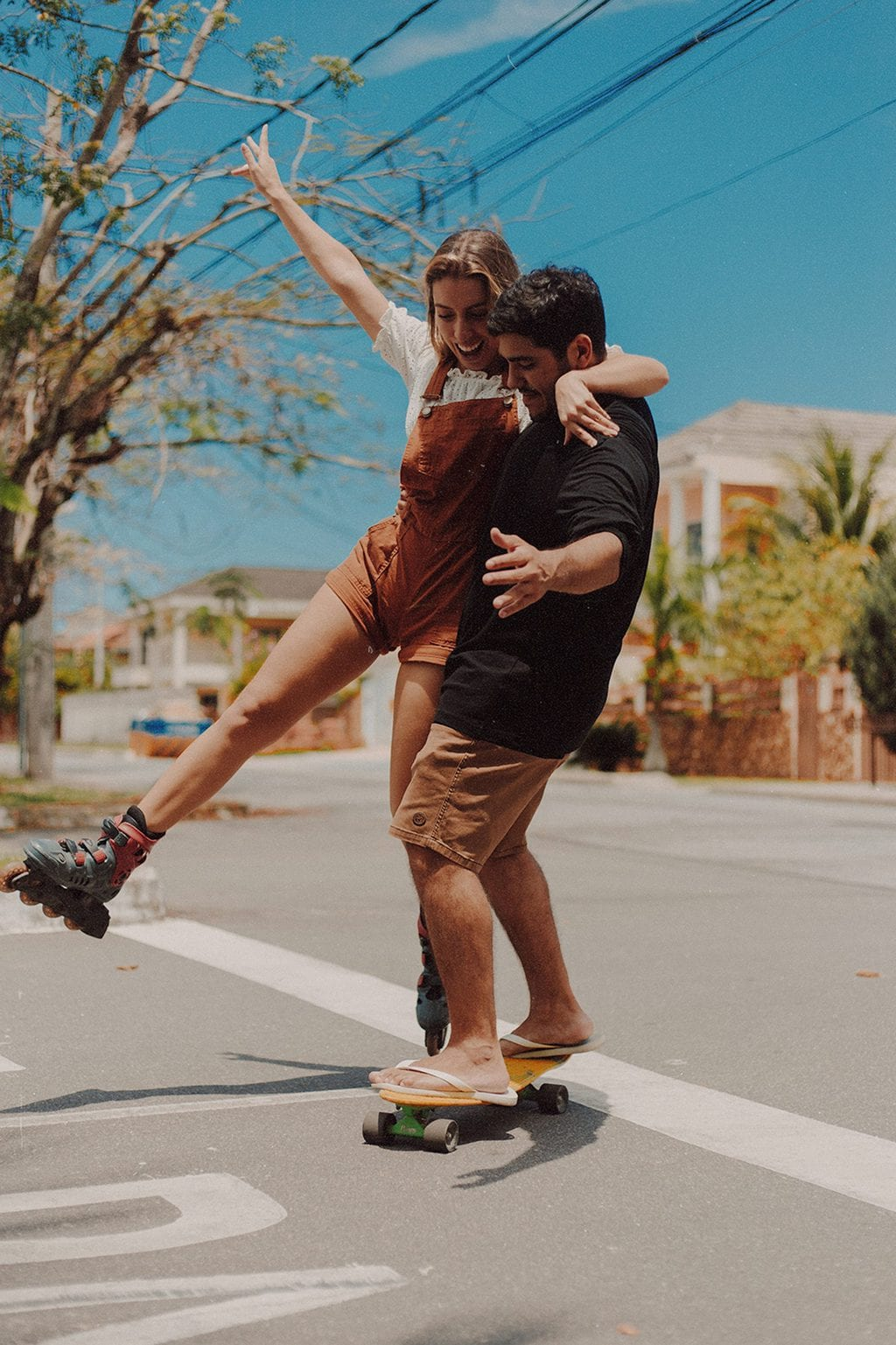 at home date ideas man and woman riding roller skates and on skateboard source: Pexels