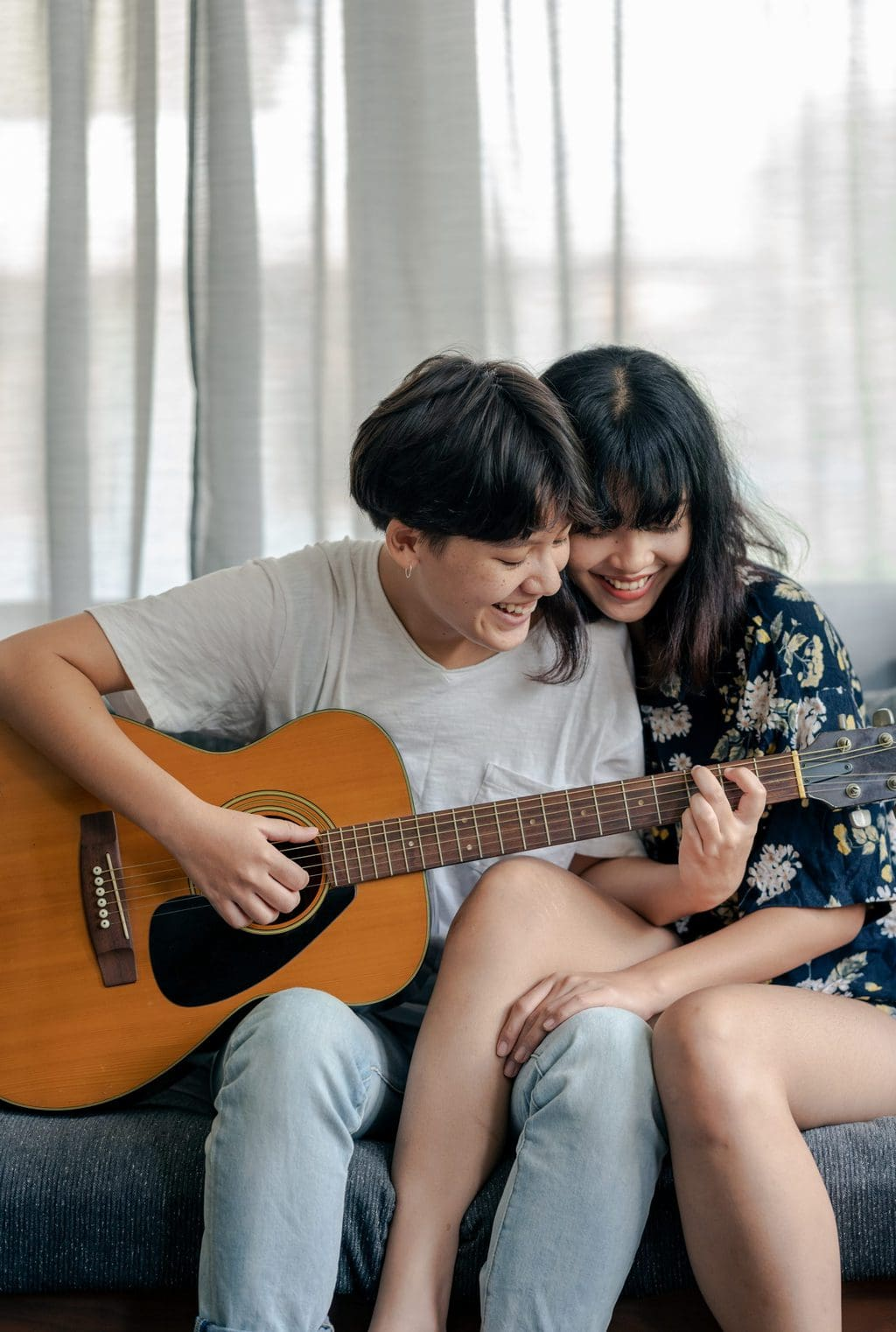 at home date ideas couple playing guitar together  source: Pexels
