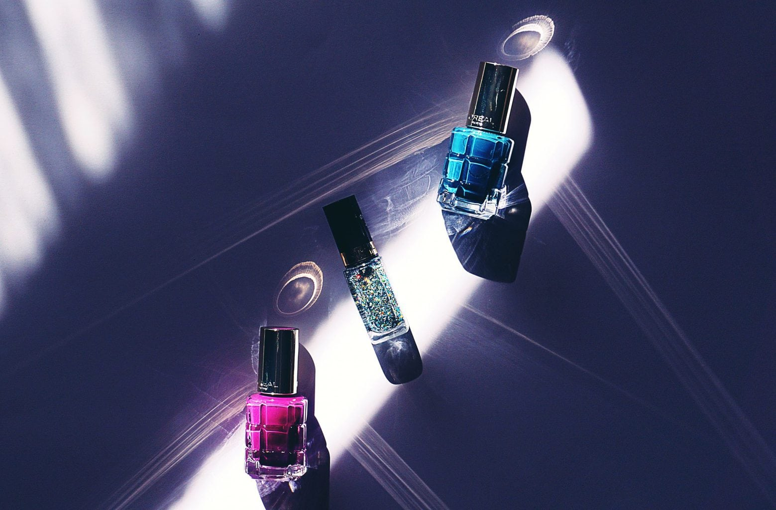 At home manicure tips: 3 nail polishes on table light shining on them source: Suzy Hazelwood from Pexels
