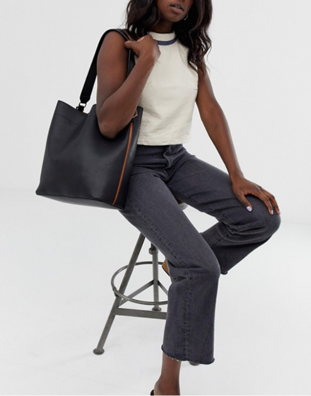 over-sized structure tote bag in black with a brown accent line