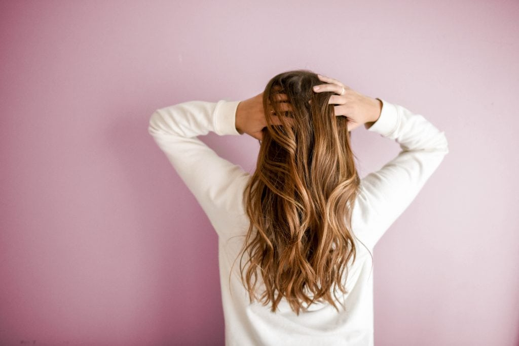 Stock photo of a woman running her hands through her hair