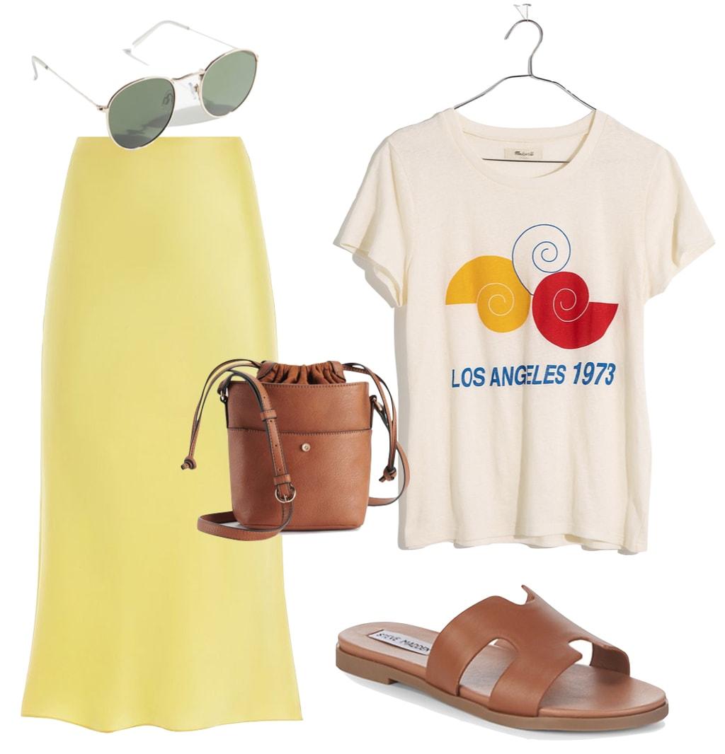 Alessandra Ambrosio: yellow silk slip midi skirt, beige graphic print t-shirt, round metal sunglasses, brown bucket bag, and brown flat sandals
