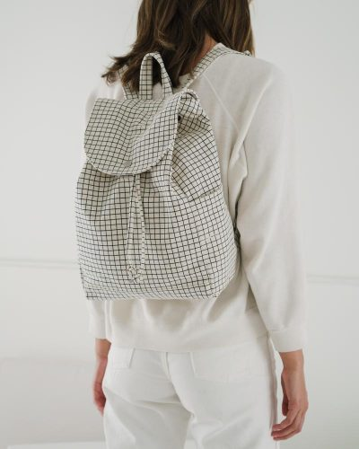 canvas satchel drawstring pack with a grid design