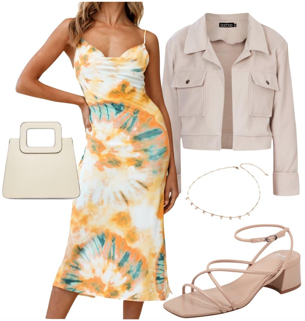 Jordyn Woods Outfit #2: orange tie-dye slip midi dress, beige crop jacket, cream handbag, rhinestone charm necklace, and beige strappy sandals