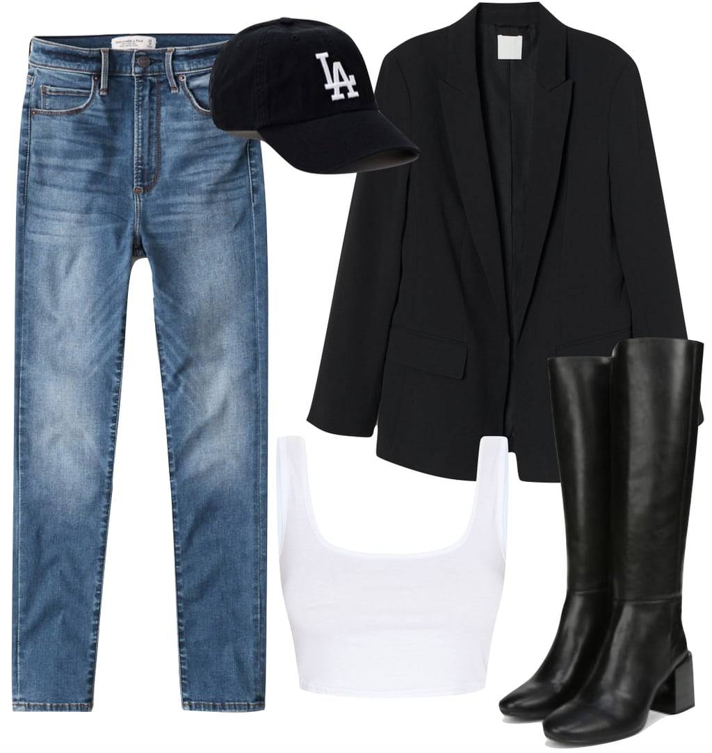 Jordyn Woods Outfit #3: skinny jeans, black blazer, L.A. Dodgers baseball cap, white crop top, and black faux leather knee-high boots