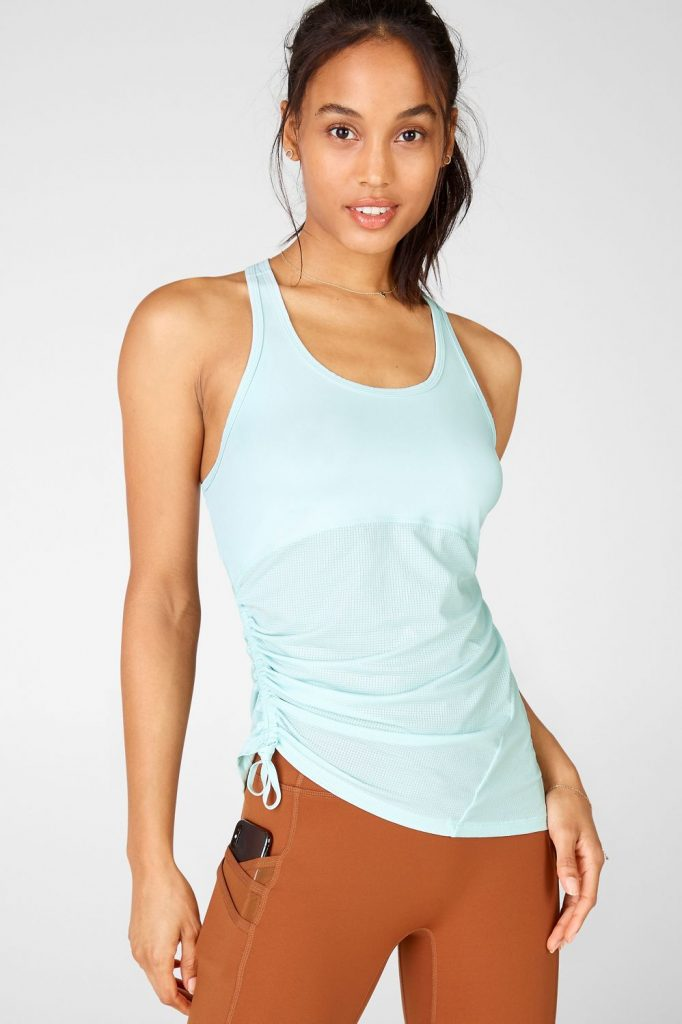 Teal Fabletics cinched workout top