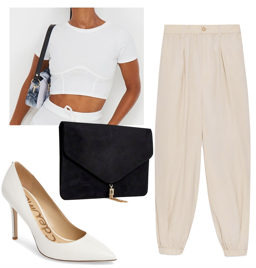 Vanessa Hudgens Outfit: white corset crop t-shirt, beige cuffed pants, white pointy toe pumps, and a black rectangular clutch bag