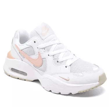 white and accent pink Nike sneakers