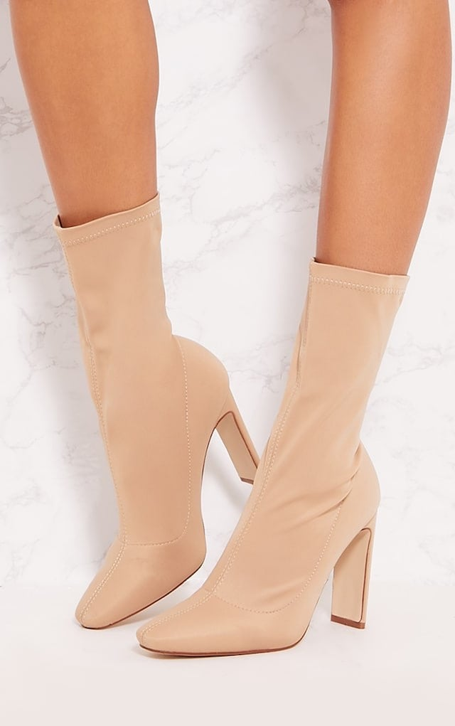 A pair of neutral heeled boots from Pretty Little Thing