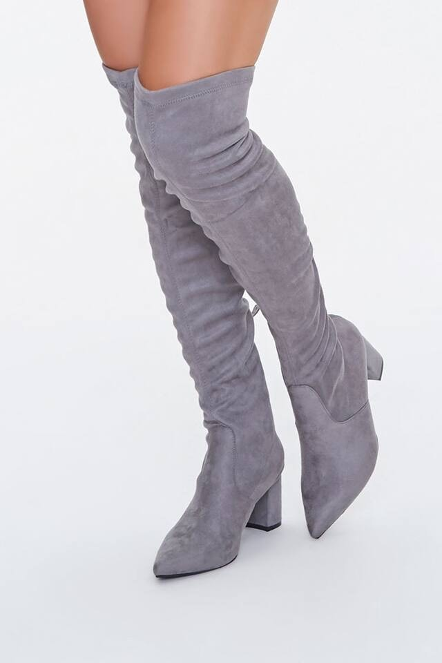 A pair of Forever 21 grey over-the-knee boots