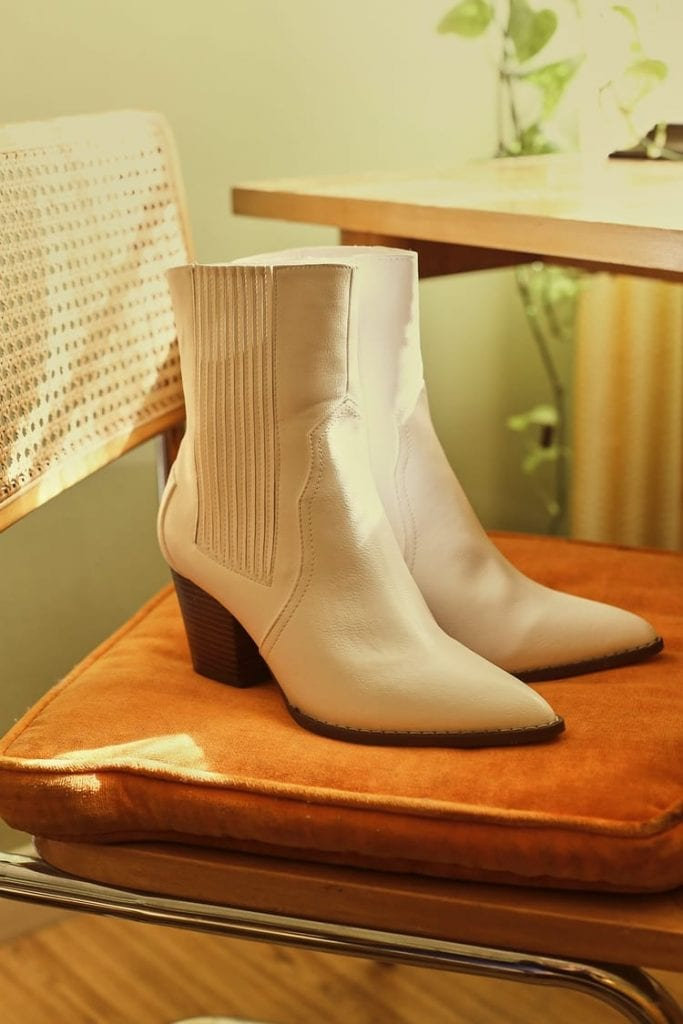 A pair of white ankle booties from Lulus