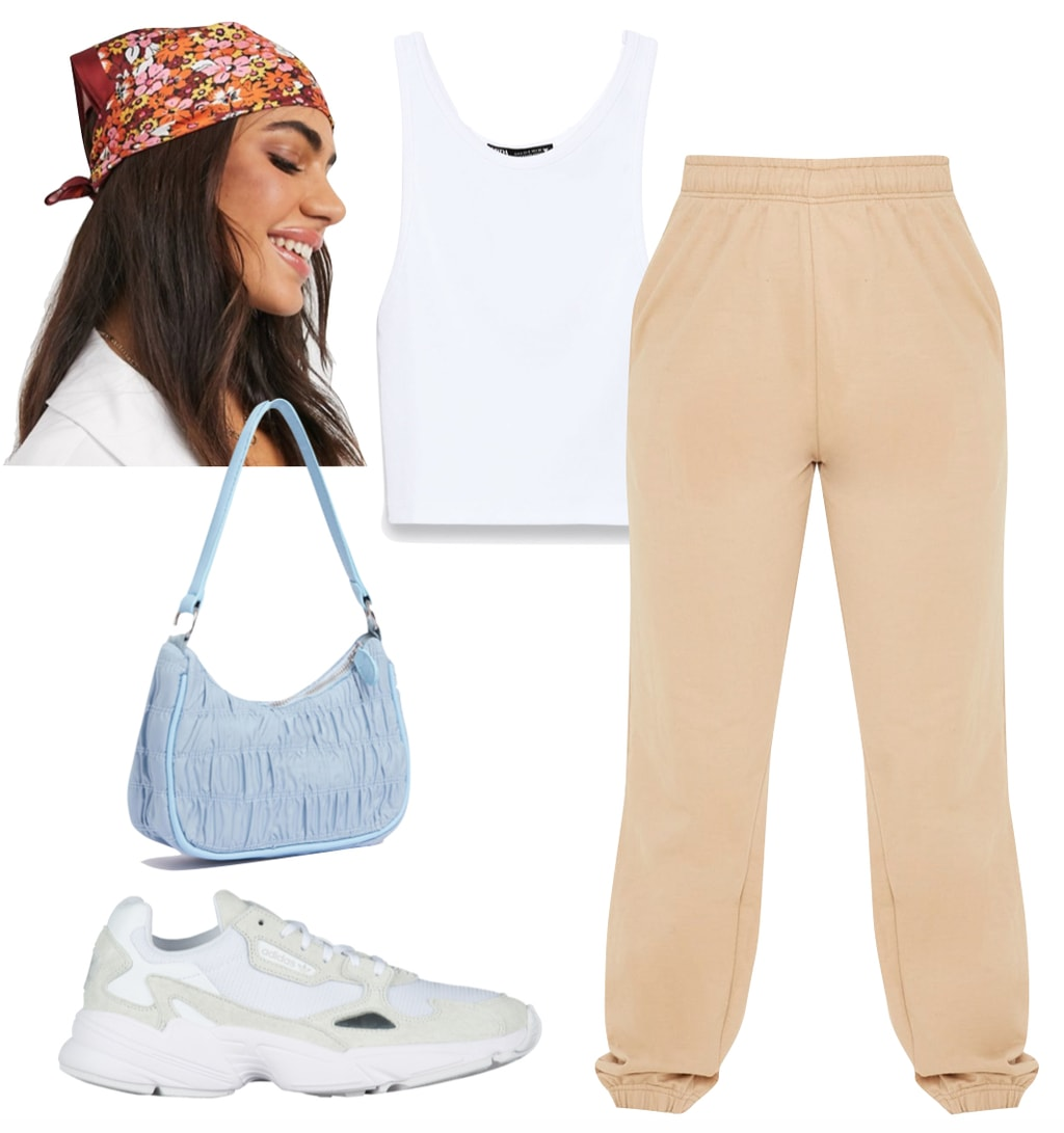 Kylie Jenner Outfit 2: beige jogger sweatpants, white crop tank top, multicolor floral print head scarf, blue ruched shoulder bag, and beige sneakers