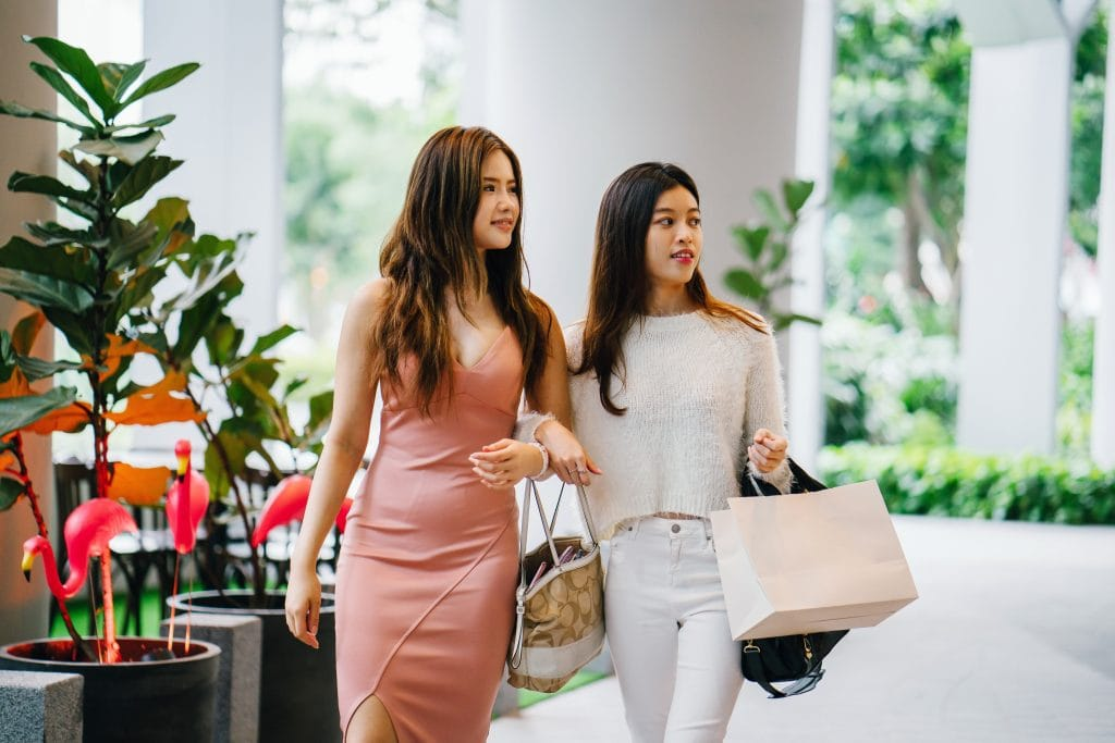 Closet organization tips - follow the one in, one out rule | Photo of two girls shopping