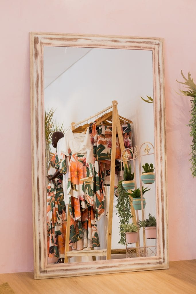 mirror reflecting room with clothes rack