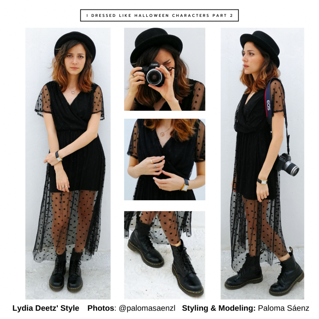 Halloween outfit inspired by Lydia Deetz from Beetlejuice with black sheer dress, bowler hat, doc martens, and camera