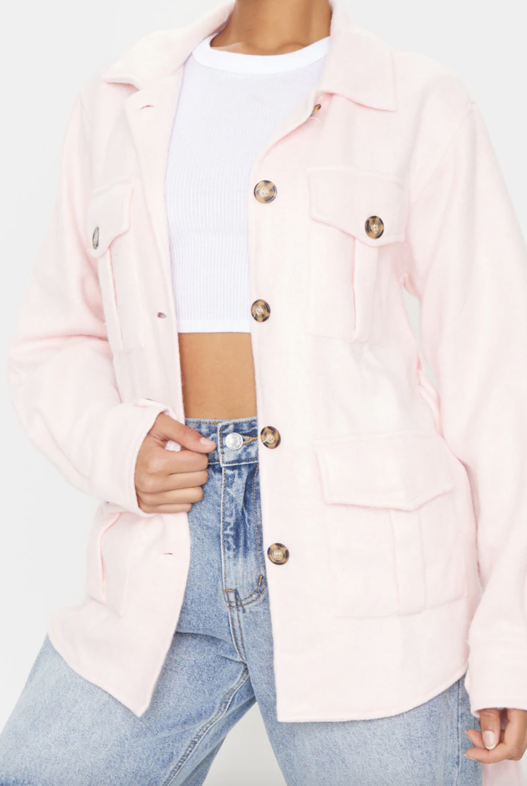 Pale pink belted dipped shacket from Pretty Little Thing