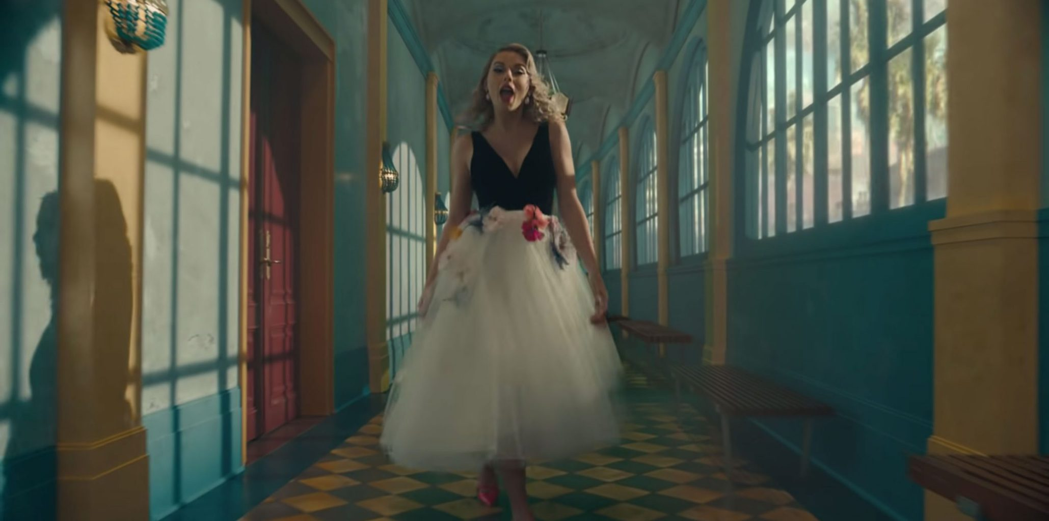 Taylor Swift in the Me music video wearing a tulle skirt and black top