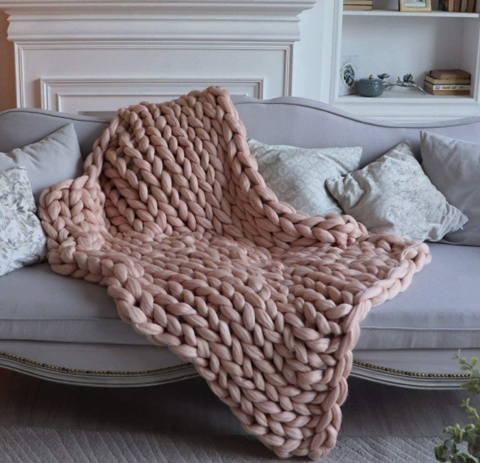 big knit rose colored blanket