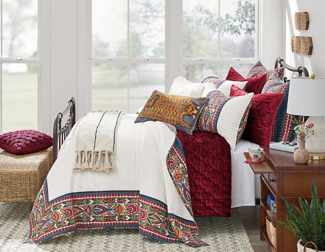 Cozy decor item: multi-colored pillows on bed