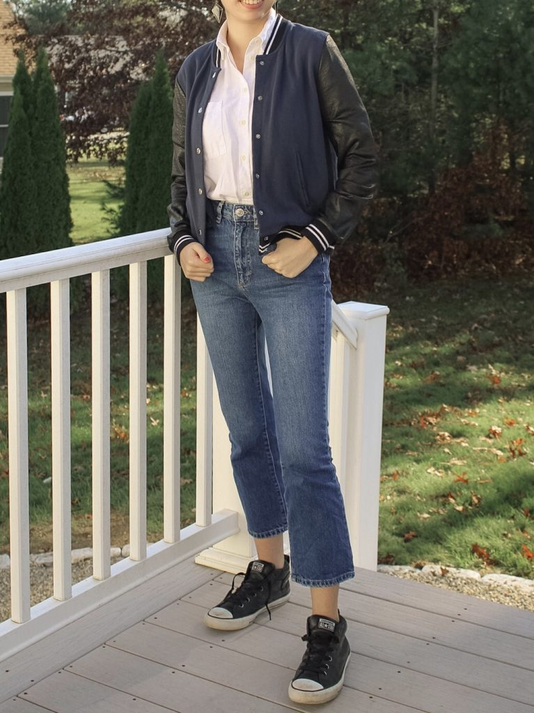 Photo of the author's outfit with jeans and a varsity jacket