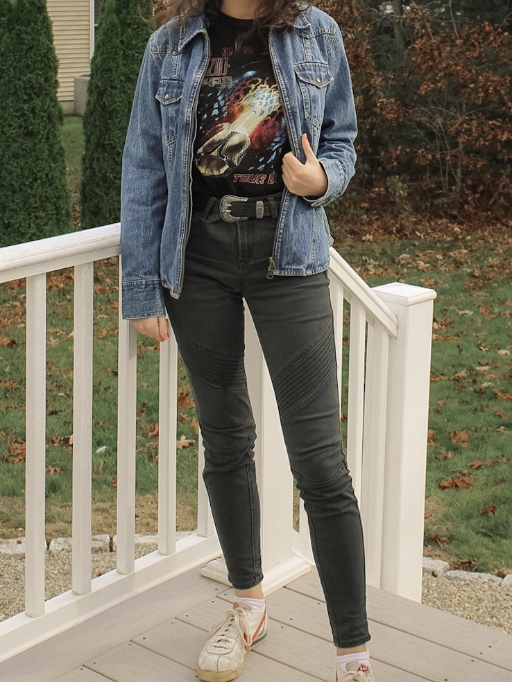 Photo of the author's outfit with a jean jacket, graphic tee, and biker pants