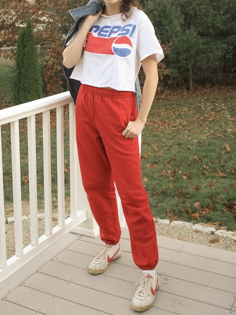 Photo of the author's outfit with sweatpants and a graphic tee