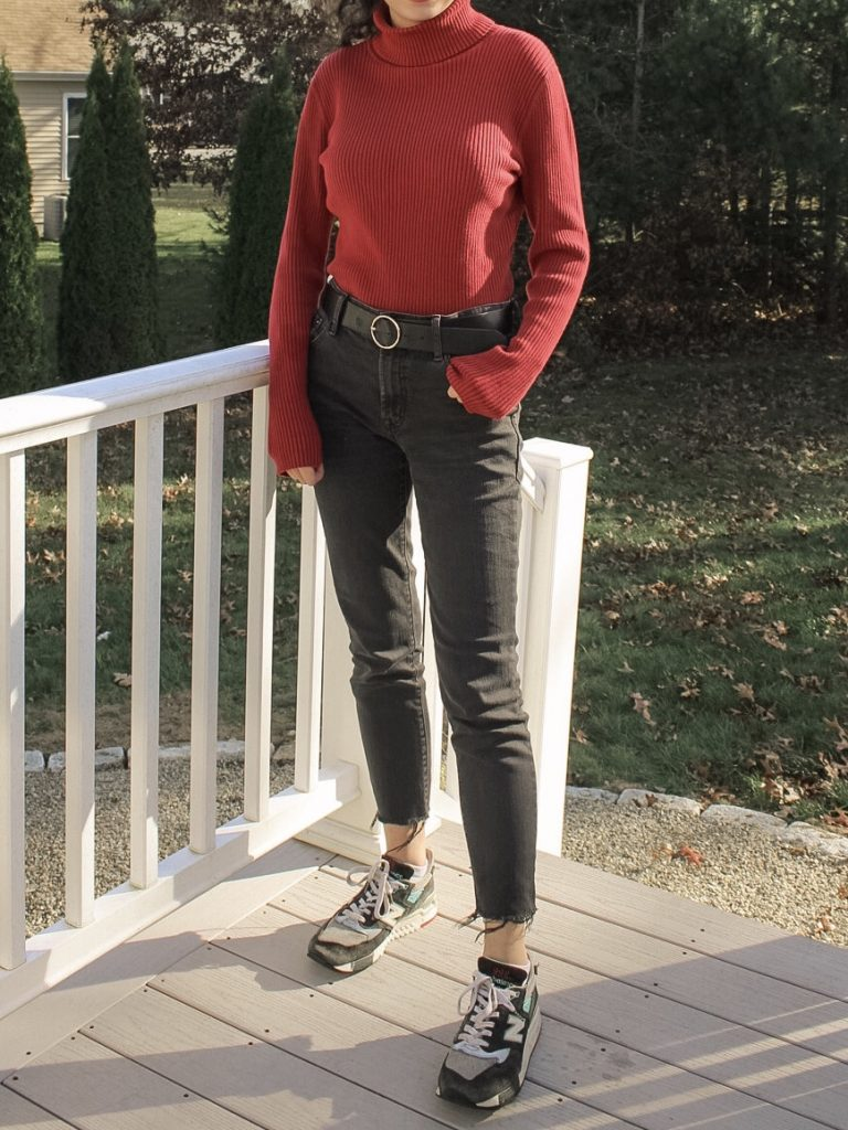 Photo of the author's outfit with a red turtleneck and black jeans