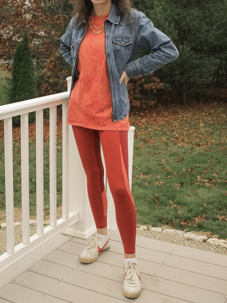 Photo of the author's outfit with orange leggings and a t-shirt
