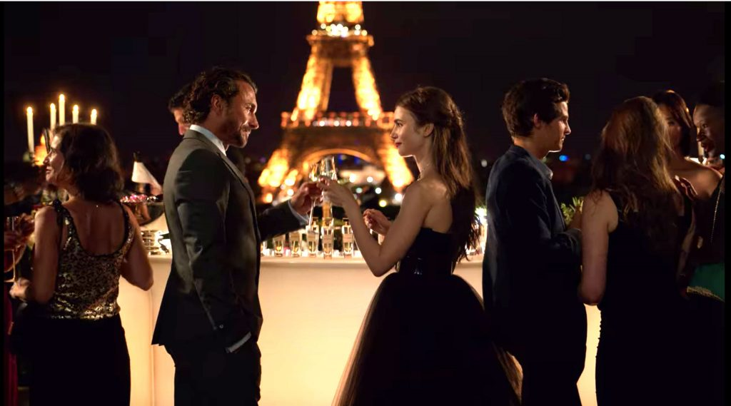 Emily in Paris outfits - photo of emily in front of the Eiffel tower in a black tulle strapless dress