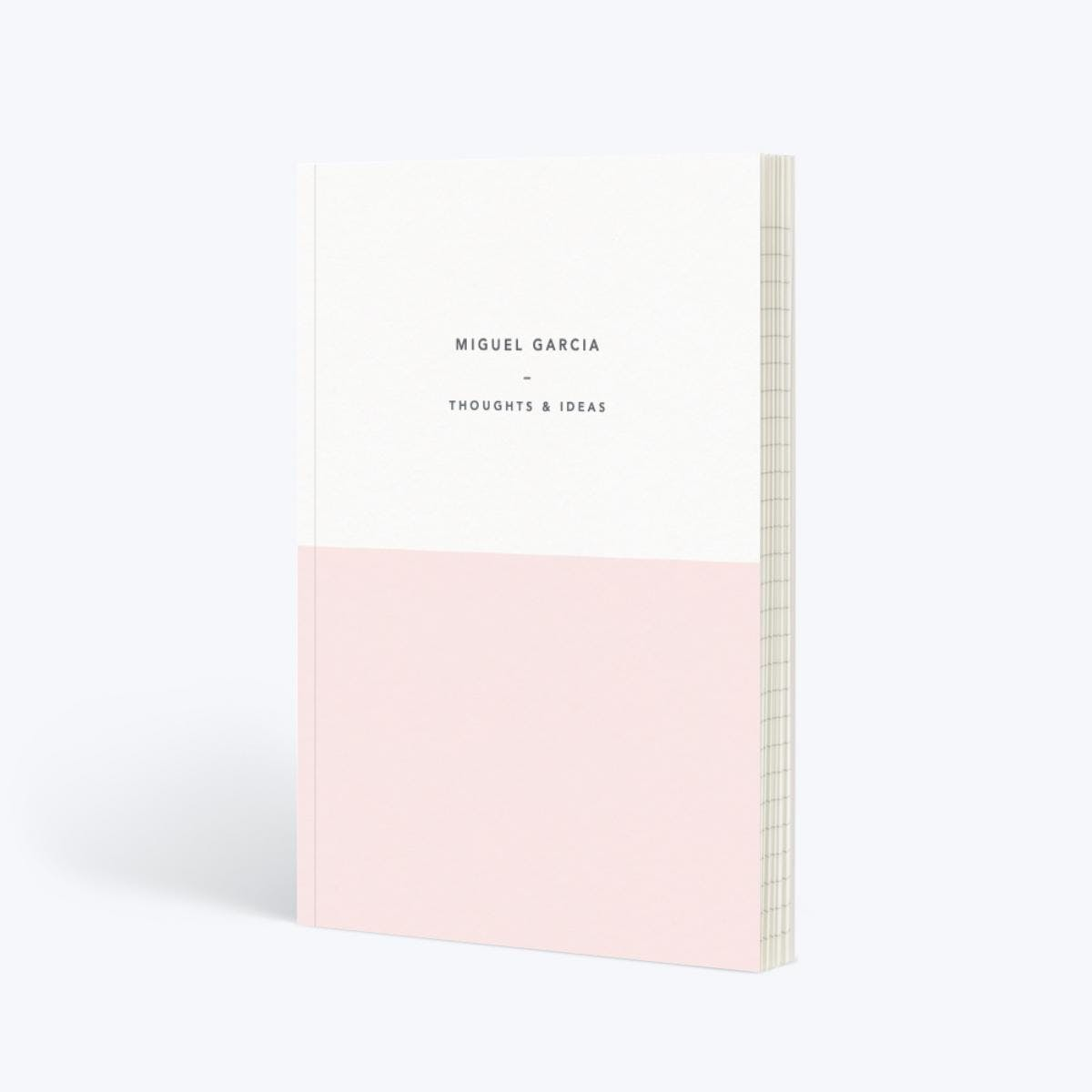 white and light pink colored journal