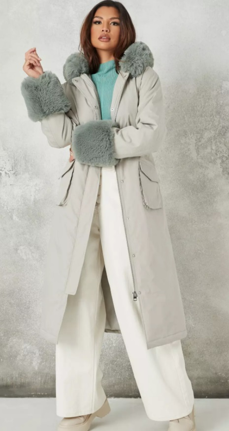 Long statement coat with grey-green cuffs and hood fur