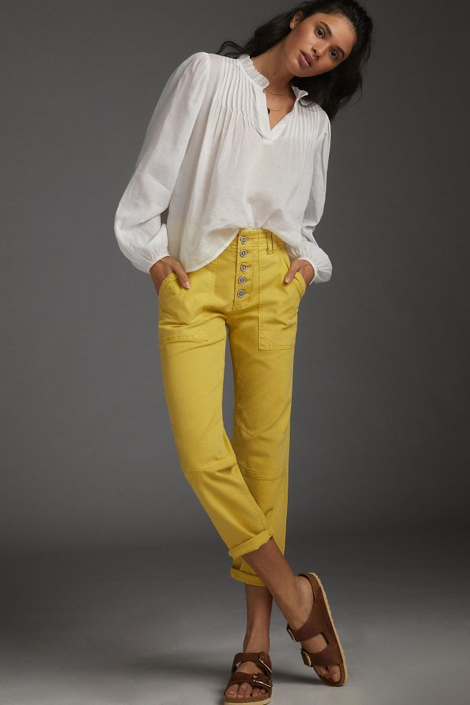 cropped cuffed yellow high-waisted jeans