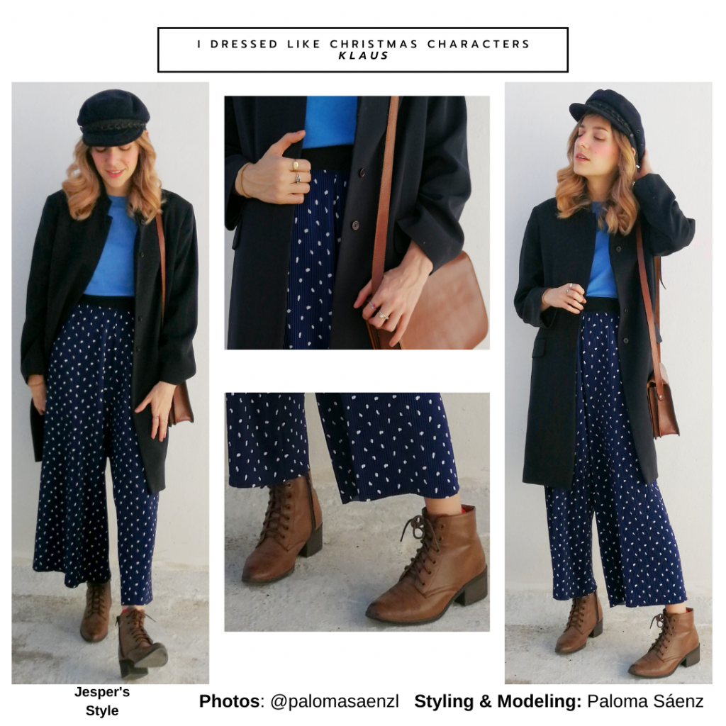 Christmas movie outfit inspired by Jesper from Klaus with polka dot pants, blue top, long coat, brown boots, crossbody bag, baker boy cap
