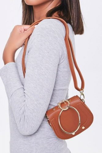 small, brown saddle bag with giant gold rings from Forever 21