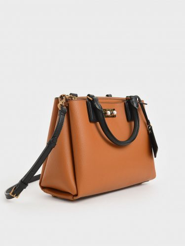 Classic bag: brown and black structured purse from Charles & Keith