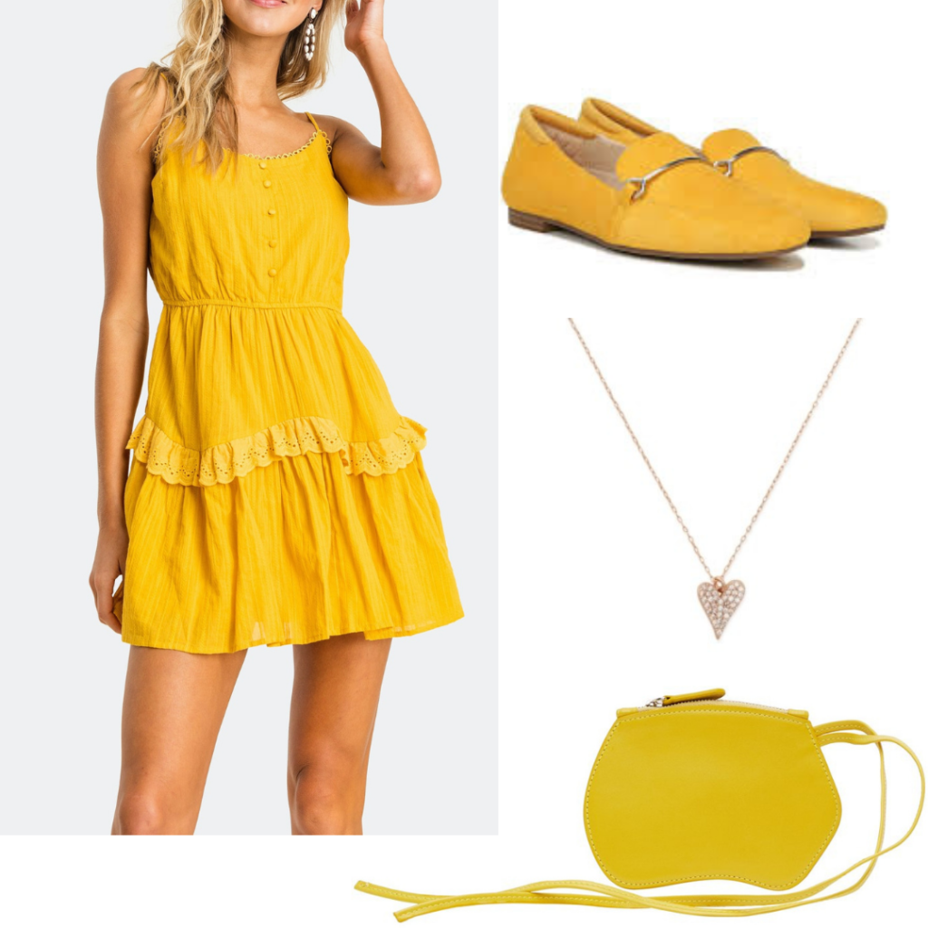 A full yellow outfit including dress, shoes and heart pendant.